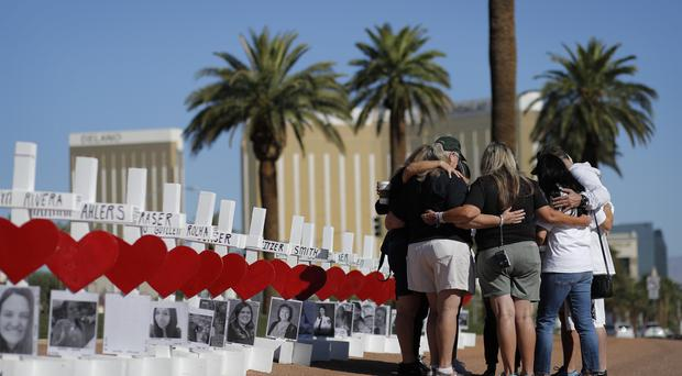 People pray at a makeshift memorial for the shooting victims (John Locher/AP)
