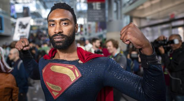 An attendee dressed as Superman (AP)