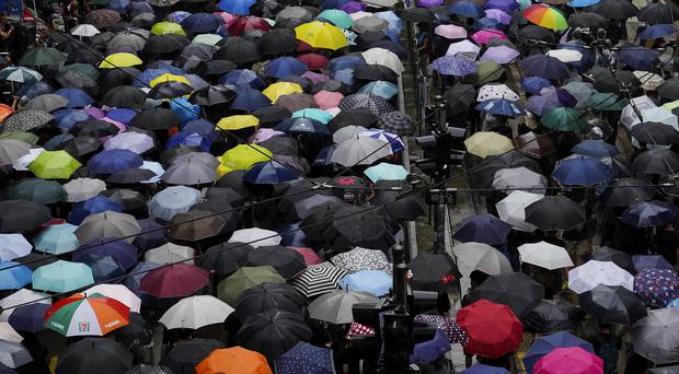 Protesters carrying umbrellas march on a rainy day in Hong Kong (Vincent Yu/AP)