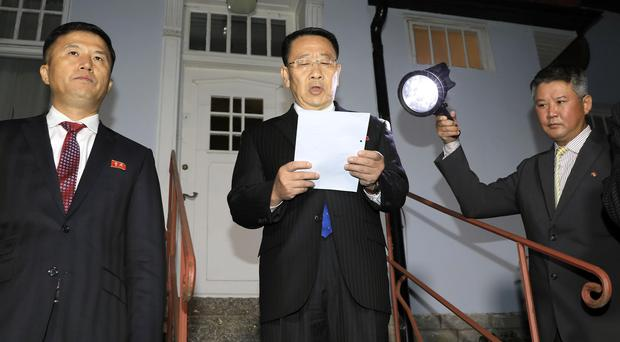 North Korean negotiator Kim Miyong Gil reads a statement outside the North Korean Embassy in Stockholm, Sweden (Kyodo News/AP)