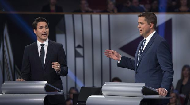 Conservative leader Andrew Scheer, right, and Liberal leader Justin Trudeau debate a point (Justin Tang/AP)