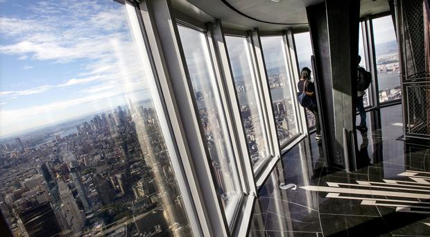 People look at the view from the 102nd floor observatory of the Empire State Building (Richard Drew/AP)