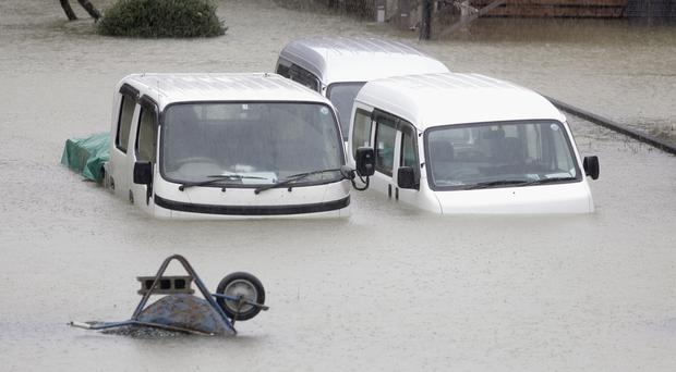 Cars submerged in water in Ise, central Japan (Kyodo News/AP)