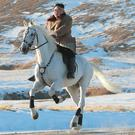 North Korean leader Kim Jong Un rides a white horse to climb Mount Paektu, North Korea (AP)