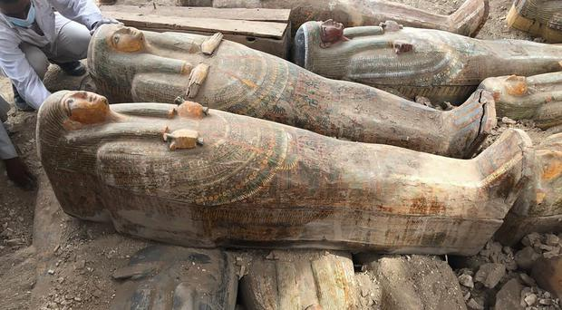 Ancient coffins with inscriptions and paintings have been found in the city of Luxor, Egypt (Egyptian Ministry of Antiquities via AP)