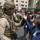 An army soldier argues with woman in the street, after a night of riots in Santiago, Chile (Esteban Felix/AP)