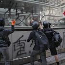 Protesters smash glass panels at Tsim Sha Tsui MTR station during a rally in Hong Kong (Kin Cheung/AP)