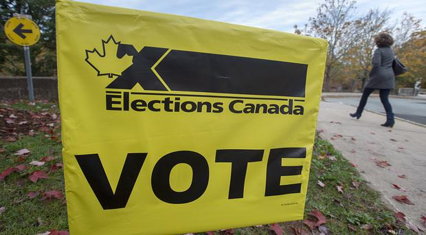 A voter heads to cast their vote in Canada's federal election at the Fairbanks Interpretation Centre in Dartmouth, Nova Scotia (Andrew Vaughan/The Canadian Press via AP/PA)