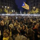 People hold up their phones with the torches switched on during a Catalan pro-independence protest in Barcelona on Sunday (Ben Curtis/PA)