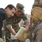 Bashar Assad meets Syrian troops (Facebook page of the Syrian Presidency via AP)