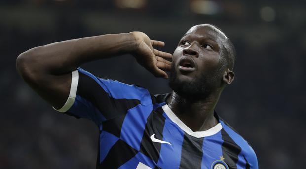 """FILE – In this Saturday, Sept.21, 2019 file photo, Inter Milan's Romelu Lukaku celebrates after scoring during a Serie A soccer match between AC Milan and Inter Milan, at the San Siro stadium in Milan, Italy. The Italian soccer federation is considering employing an advanced listening device used in anti-terrorism operations to identify fans who sing racist chants. Federation president Gabriele Gravina has detailed """"a passive radar device that uses directional microphones to determine the source of the noise."""" (AP Photo/Luca Bruno, File)"""