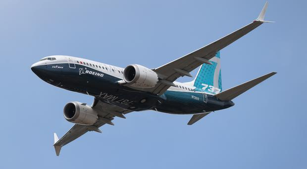 A Boeing 737 Max gives a display during the opening day of the Farnborough International Airshow (Andrew Matthews/PA)