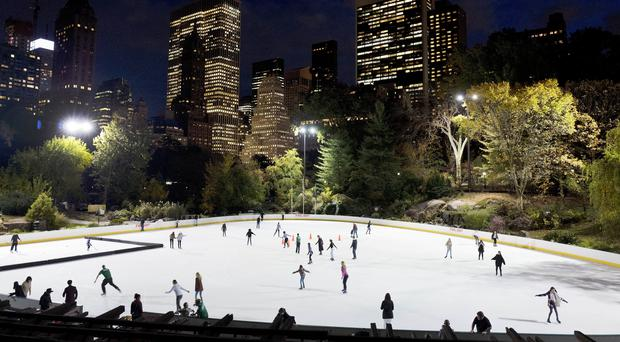 Skaters take to the ice at Wollman Rink in New York's Central Park (Mark Lennihan/PA)