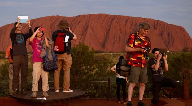 Climbers have rushed to climb Australia's Uluru before it is banned to take to the sacred rock (Anthony Devlin/PA Wire)