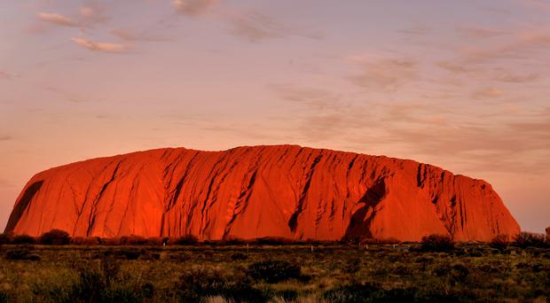 The sun sets at Uluru in the Northern Territory (Anthony Devlin/PA)