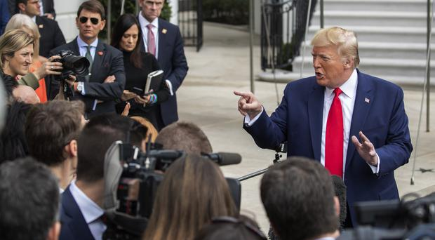 President Donald Trump speaks to reporters as leaves the White House on Friday, a day in which he continued to send confusing messages about the US presence in Syria (Manuel Balce Ceneta/AP)