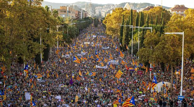 Catalan pro-independence protesters march during a demonstration in Barcelona (AP)