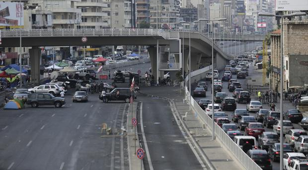 Cars stuck in a traffic jam as anti-government protesters block a highway in Beirut (AP/Hassan Ammar)
