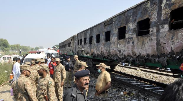 Pakistani soldiers and officials examine the train (AP)