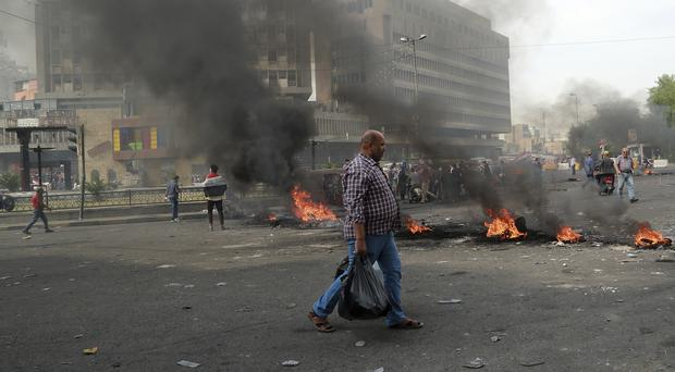 Fires set by demonstrators close roads during ongoing anti-government protests (AP/Hadi Mizban)