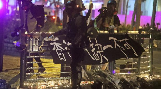 Hong Kong MPs are facing detention and arrest, according to local police, over their alleged roles in sparking ongoing protests (Kin Cheung/AP)