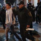 Bolivia's ex-president has said he has been granted to asylum in Mexico as protests continue to rage (Natacha Pisarenko/AP)