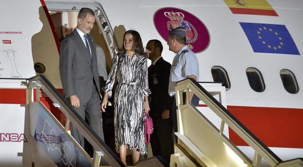 King Felipe and Queen Letizia, centre, have arrived in Cuba (Yamil Lage/Pool photo via AP)