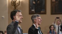 George Kent and William Taylor take an oath before testifying (Scott Applewhite/AP)