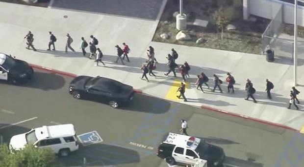People are led out of Saugus High School after reports of a shooting (KTTV-TV via AP)