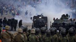 Security forces and backers of former President Evo Morales clash in Sacaba, Bolivia (Dico Solis/AP)