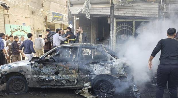 People check the aftermath of a car bomb explosion in the city of al-Bab, northern Syria (Albab City via AP)