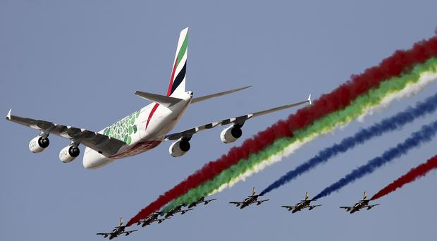 An Emirates Airline A-380 leads the Al Fursan, or the Knights, a UAE Air Force aerobatic display team during the opening day of the Dubai Airshow (Kamran Jebreili/AP)