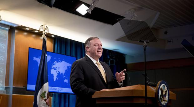 Secretary of State Mike Pompeo speaks at a news conference (Andrew Harnik/AP/PA)
