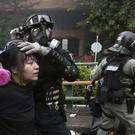 Riot police detain protesters at Hong Kong Polytechnic University (Achmad Ibrahim/AP)