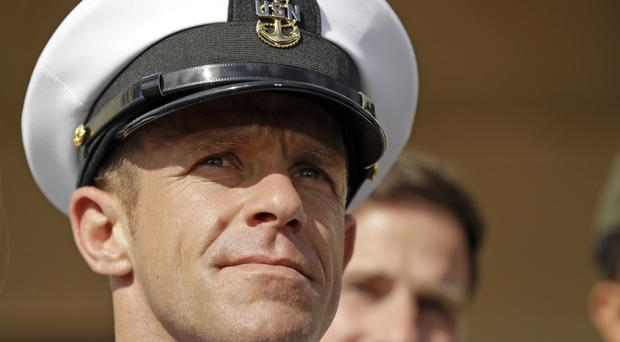 Navy Special Operations chief Edward Gallagher leaves a military court (Gregory Bull/AP)