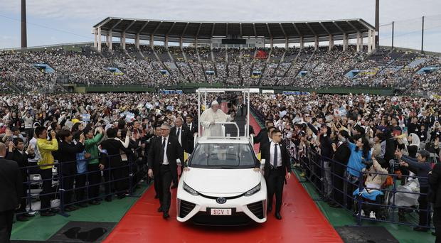 Pope Francis standing on a popemobile made by Japanese carmaker Toyota (Gregorio Borgia/AP)