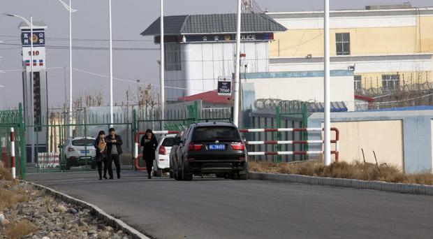 A police station is seen by the front gate of the Artux City Vocational Skills Education Training Service Centre in Artux in western China's Xinjiang region (AP)