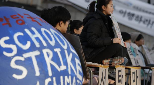 South Korean students hold banners during a climate change protest (Lee Jin-man/AP)