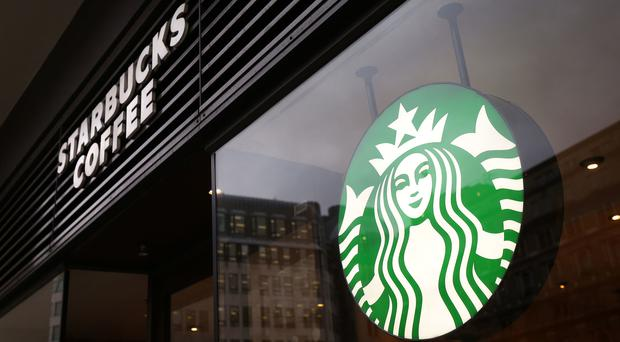 Starbucks apologised to the force (Philip Toscano/AP)