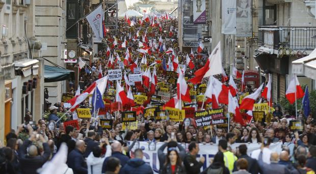 People stage a protest in Valletta, Malta (AP)