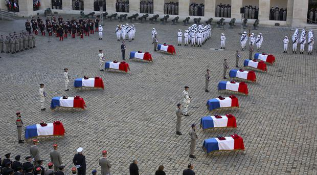 Coffins of 13 French soldiers killed in Mali (Rafael Yaghobzadeh/AP)