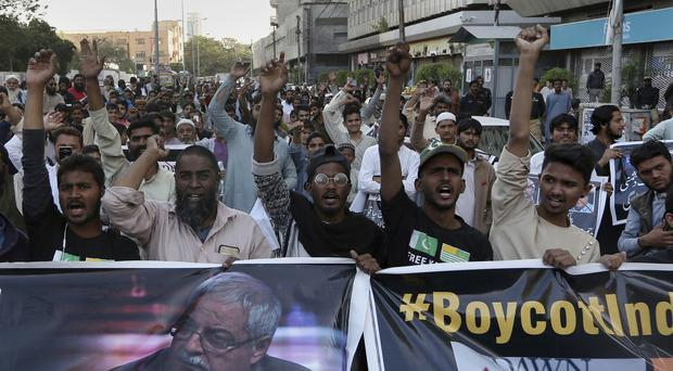 Protests over the independent Pakistani newspaper Dawn outside the Press Club in Karachi (AP)