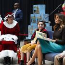 First Lady Melania Trump reads a Christmas book to children at Children's National Hospital in Washington (Jacquelyn Martin/AP)