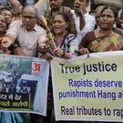 Indians light fire crackers and shout slogans in favour of police to celebrate the killings of four men suspected of raping and killing a woman in Shadnagar in the southern state of Telangana, in Ahmadabad, India (Ajit Solanki/AP)