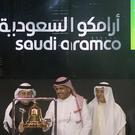 Saudi Arabia's state-owned oil company Armco and stock market officials celebrate during the official ceremony marking the debut of Aramco's initial public offering on Riyadh's stock market (Amr Nabil/AP)