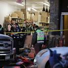 Emergency responders work at a kosher supermarket, the site of a shooting in Jersey City, N.J., Wednesday, Dec. 11, 2019. The mayor of the New Jersey city said Wednesday that authorities believe gunmen targeted the market during a furious shooting that killed multiple people and filled the streets with the sounds of heavy gunfire for hours just across the Hudson River from New York City. (AP Photo/Seth Wenig)