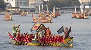 Oarsmen paddle one of the royal barges during the procession on the Chao Phraya River Bangkok, Thailand (Sakchai Lalit/AP)