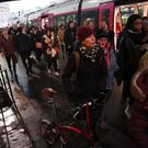 Commuters try to get on a train at the Gare Saint Lazare station in Paris (Francois Mori/AP)