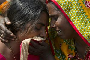 Women grieve the deaths of their relatives (Niranjan Shrestha/AP)