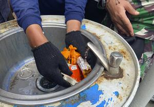 Indonesian navy personnel inspect a part the flight data recorder recovered at the crash site of the Sriwijaya Air flight (Fadlan Syam/AP)